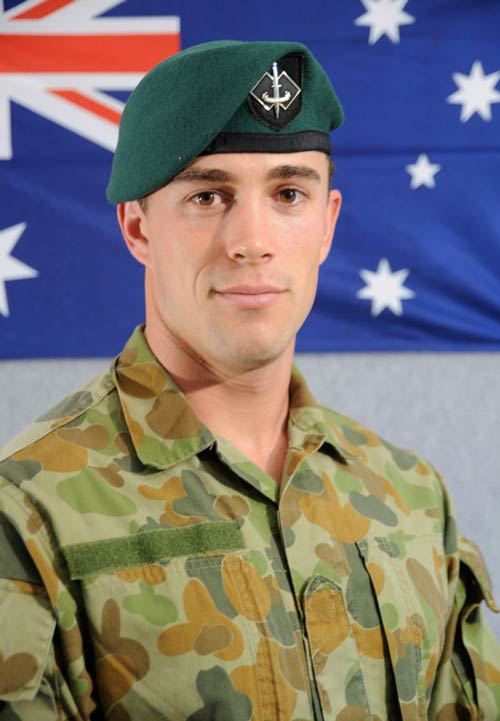 An Australian Army soldier salutes during the welcome home